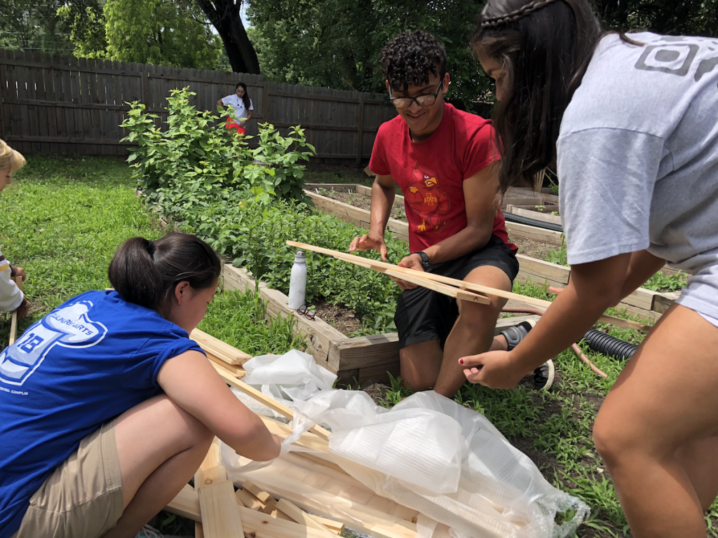 Students construct a raised bed garden.
