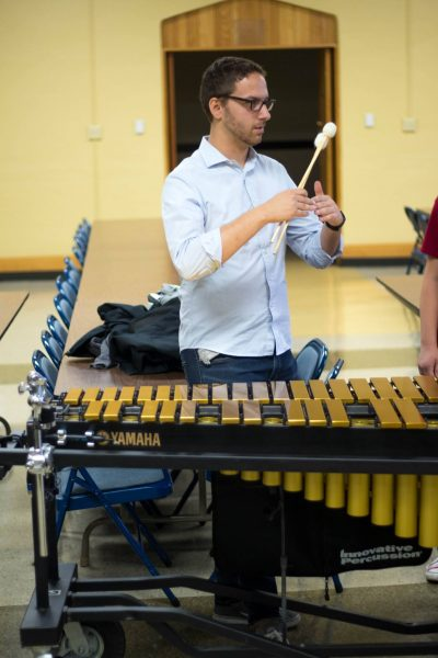 A student with a marimba.
