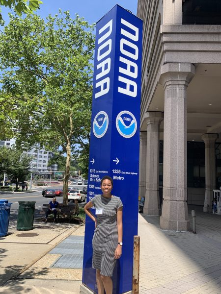 Toni Sleugh in front of NOAA sign